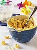 Bowl of Macaroni and Cheese for a Child; Partially Eaten Glass of Milk
