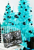 Blue Christmas trees and black-and-white wrapped Christmas presents