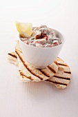 An aubergine dip with pitta bread
