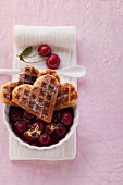 Heart-shaped waffles made from spelt flour with cherry compote