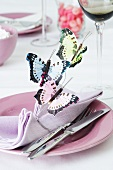 A napkin decorated with paper butterflies