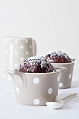 Chocolate muffins in spotted baking tins