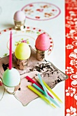 Colourful Easter eggs in silver egg cups