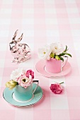 Easter decorations with lisianthus flowers in mocha cups and a silver bunny
