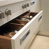An open cutlery drawer