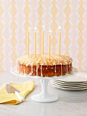 Lemon cake with candles on a cake stand