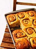 Sticky buns on a baking tray