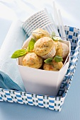 Spicy muffins with basil and paper cups
