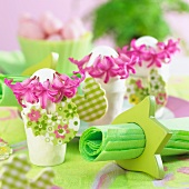 Easter table decorations with hyacinths flowers and chick figures