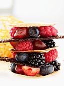 A tower of fresh berries and caramel sheets