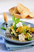 Marinated courgettes with feta cheese, oranges and basil