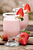 Strawberry smoothie in glasses with a sugared rim