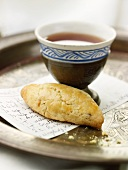 Homemade Anise Cookie with Recipe Card and Cup of Tea