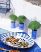 A selection of Greek appetisers on a table in the open air
