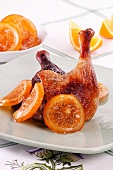 Roast duck leg with oranges
