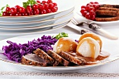 Roast goose breast with dumplings, red cabbage and gravy