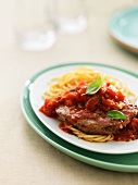 Beefsteak alla pizzaiola with tomatoes and spaghetti