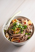Soba noodles with fish and spring onions