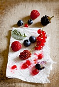 Various berries on a piece of kitchen paper