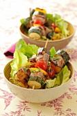 Pork and vegetable kebabs on lettuce