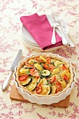 A potato, courgette and tomato quiche
