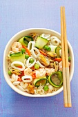 Noodle soup with prawns, squid, mussels and courgettes (Asia)