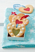 Heart-shaped Christmas biscuits with jam