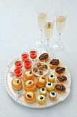 Various canapés and glasses of champagne