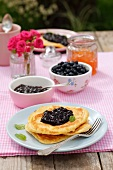 Pancakes with blueberry jam, blueberries and marmalade