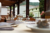 A table laid on the terrace of a restaurant in Sardinia
