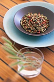 A bowl of colourful peppercorns