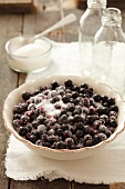 Blackberries with sugar and bottles