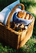 Bread and wine in a picnic basket