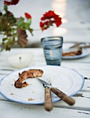 Food remains on a plate with cutlery