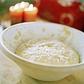 Yeast dough rising in a bowl
