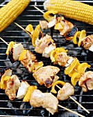 Kebabs and corn cobs on a barbecue