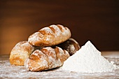 Loaves of bread and a pile of flour