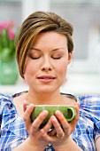 A woman enjoying a cup of tea