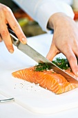Salmon being portioned