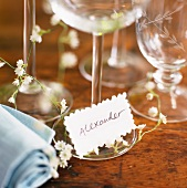 Place cards and wine glasses