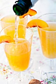 Nectarine cocktails with champage