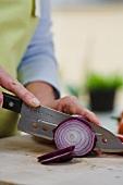 An onion being cut