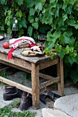 Bread and cheese on rustic bench outdoors