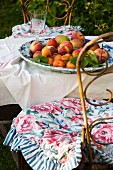 China dish of fresh fruit on garden table outdoors