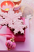 Christmas biscuits decorated with pink icing as a gift