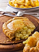Cheese and onion pasty, cut
