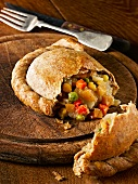 Wholemeal vegetable pasty, cut