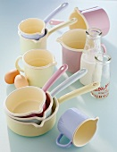 Enamel pots, eggs and milk