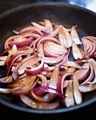 Sliced Red Onions Cooking in a Skillet
