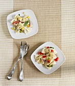 Two Plates of Pasta Salad; Country Chicken and Tuscan; Both Made with Farfalle Pasta